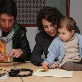 Gonzalo Rodríguez, Cata nuestra subgerente y su hija, Elisa, cuando bebé.